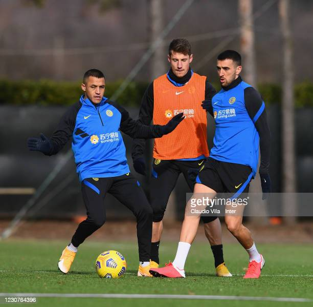 Alexis Sanchez, Andrea Pinamonti and Matias Vecino of FC Internazionale in action during a training session at Appiano Gentile on January 24, 2021 in...