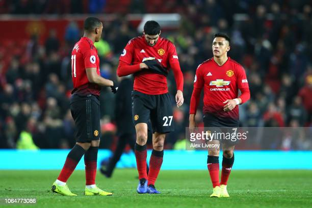 Alexis Sanchez Anthony Martial and Marouane Fellaini of Manchester United look dejected following the Premier League match between Manchester United...