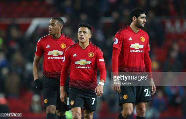 Alexis Sanchez Anthony Martial and Marouane Fellaini of Manchester United look dejected after the Premier League match between Manchester United and...