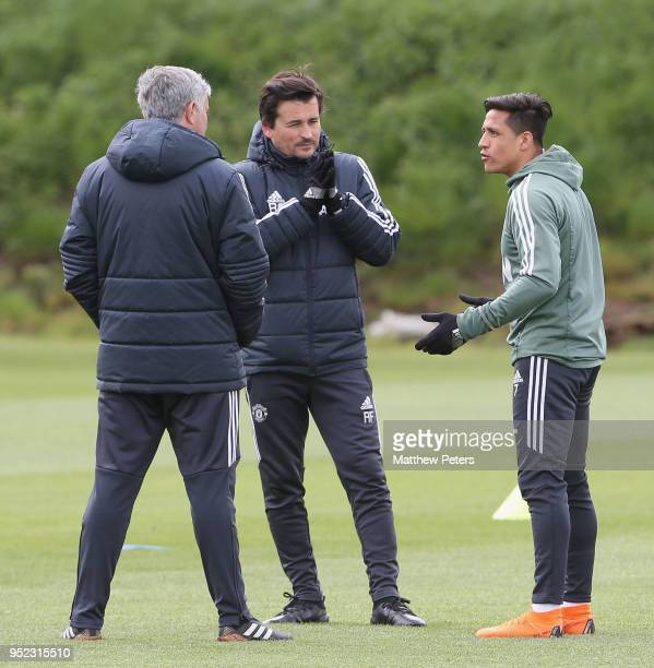 Alexis Sanchez Assistant Manager Rui Faria and Manager Jose Mourinho of Manchester United in action during a first team training session at Aon...