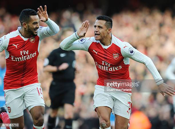 Alexis Sanchez celebrate with Theo Walcott after scoring for Arsenal during the Premier League match between Arsenal and AFC Bournemouth at Emirates...
