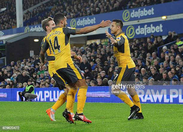 Alexis Sanchez celebrates scoring a a goal for Arsenal with Theo Walcott during the Premier League match between Everton and Arsenal at Goodison Park...