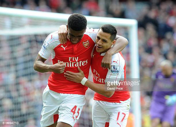 Alexis Sanchez celebrates scoring a goal for Arsenal with Alex Iwobi during the Barclays Premier League match between Arsenal and Watford at Emirates...