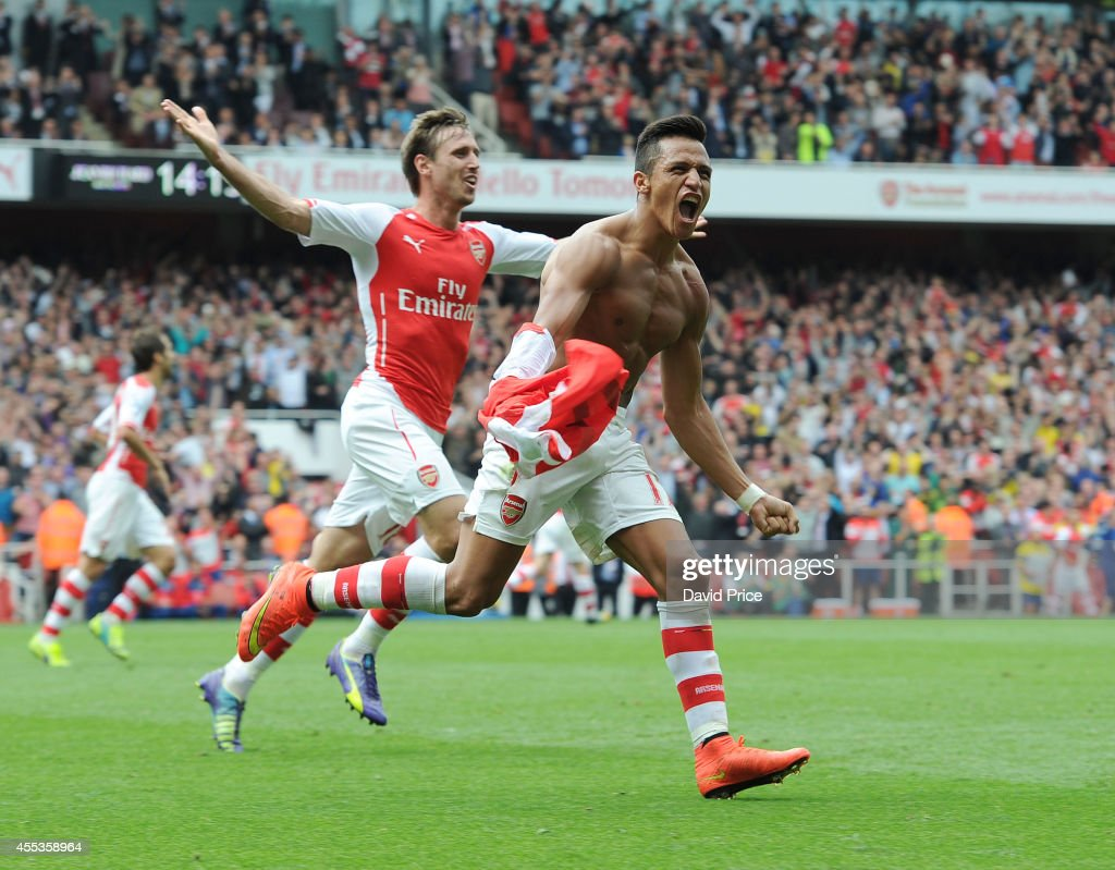 Alexis Sanchez celebrates scoring Arsenal's 2nd goal during the Barclays Premier League match between Arsenal and Manchester City at Emirates Stadium on September 13, 2014 in London, England.