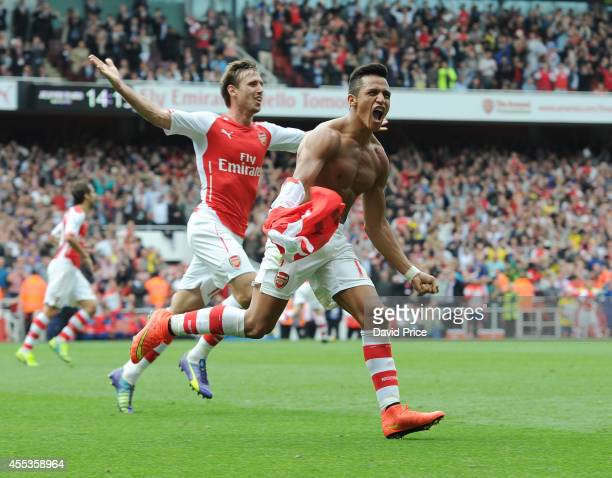 Alexis Sanchez celebrates scoring Arsenal's 2nd goal during the Barclays Premier League match between Arsenal and Manchester City at Emirates Stadium...