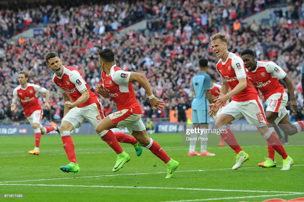 Alexis Sanchez celebrates scoring Arsenal's 2nd goal with Gabriel and Rob Holding during the match between Arsenal and Manchester City at Wembley Stadium on April 23, 2017 in London, England.