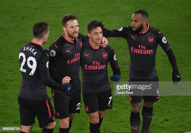 Alexis Sanchez celebrates scoring Arsenal's 2nd goal with Granit Xhaka Shkodran Mustafi and Alexandre Lacazette during the Premier League match...