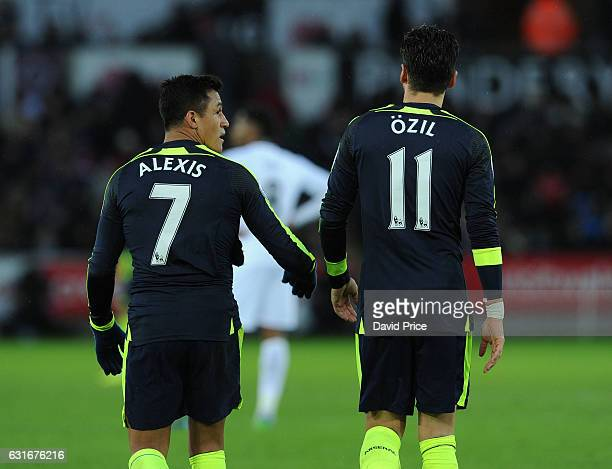 Alexis Sanchez celebrates scoring Arsenal's 4th goal with Mesut Ozil during the Premier League match between Swansea City and Arsenal at Liberty...
