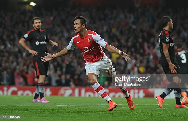 Alexis Sanchez celebrates scoring Arsenal's goal during the UEFA Champions League Qualifier 2nd leg match between Arsenal and Besiktas at Emirates...