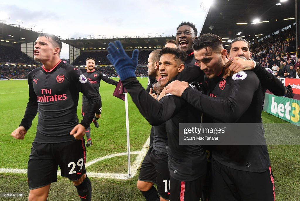 Alexis Sanchez celebrates scoring Arsenal's goal with (L) Granit Xhaka, (2ndL) Jack Wilshere, (3rdL) Danny Welbeck (R) Hector Bellerin and (2ndR) Sead Kolasinac during the Premier League match between Burnley and Arsenal at Turf Moor on November 26, 2017 in Burnley, England.