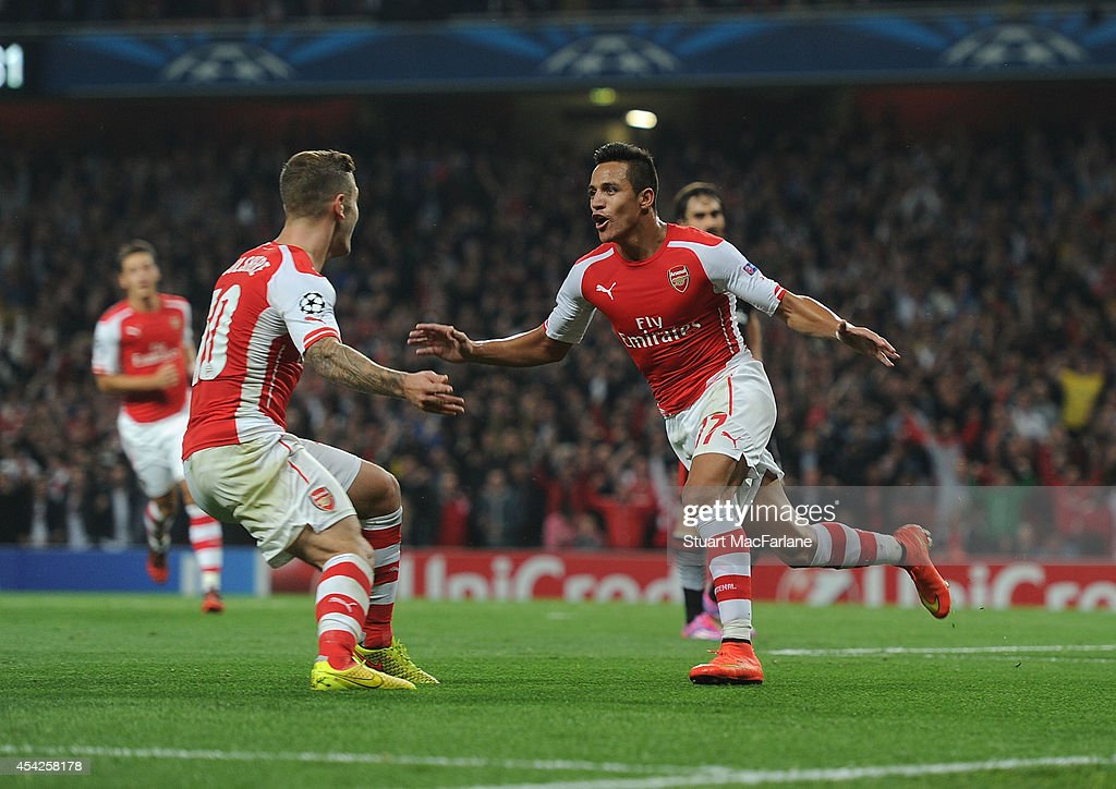 Alexis Sanchez celebrates scoring Arsenal's goal with (L) Jack Wilshere during the UEFA Champions League Qualifier 2nd leg match between Arsenal and Besiktas at Emirates Stadium on August 27, 2014 in London, United Kingdom.