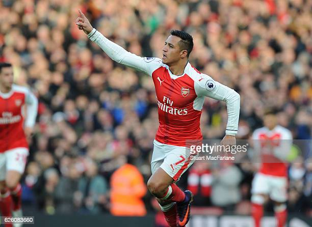 Alexis Sanchez celebrates scoring for Arsenal during the Premier League match between Arsenal and AFC Bournemouth at Emirates Stadium on November 27...