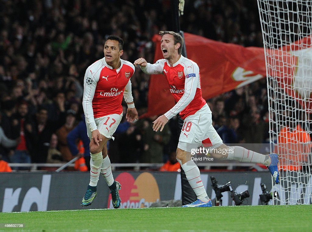 Alexis Sanchez celebrates scoring his 1st goal, Arsenal's 2nd, with Nacho Monreal during the match between Arsenal and Dinamo Zagreb in the UEFA Champions League on November 24, 2015 in London, United Kingdom.