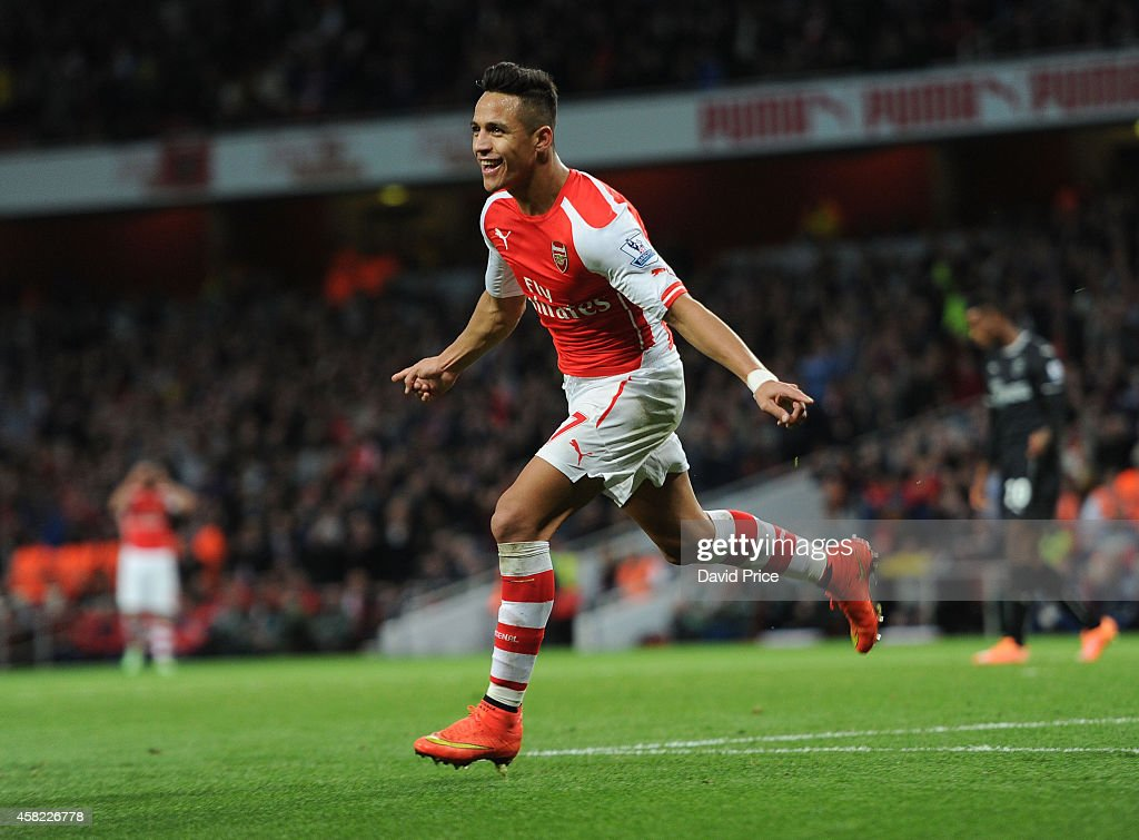 Alexis Sanchez celebrates scoring his 2nd goal Arsenal's 3rd during the match between Arsenal and Burnley in the Barclays Premier League at Emirates Stadium on November 1, 2014 in London, England.