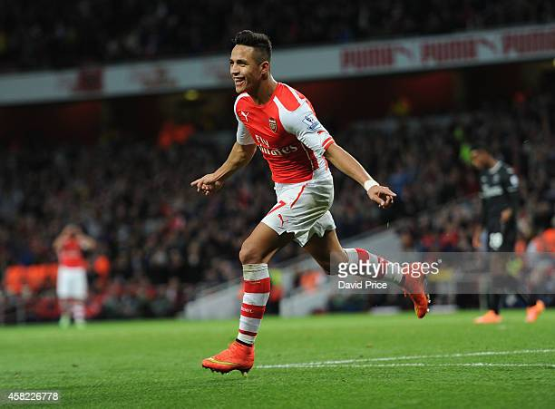 Alexis Sanchez celebrates scoring his 2nd goal Arsenal's 3rd during the match between Arsenal and Burnley in the Barclays Premier League at Emirates...