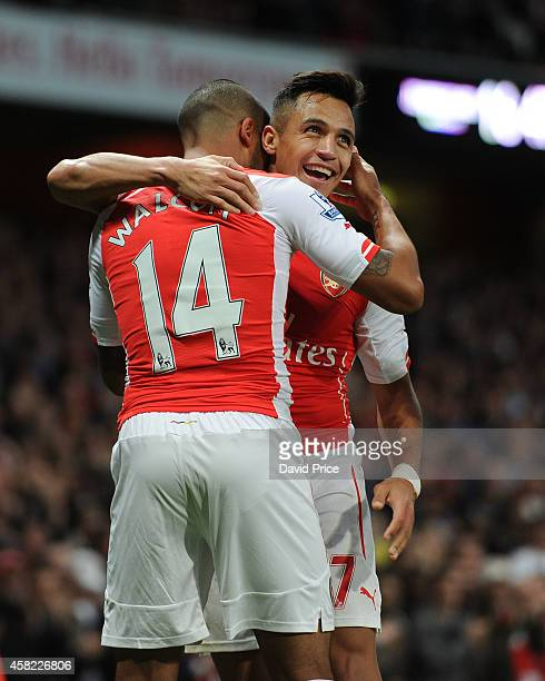 Alexis Sanchez celebrates scoring his 2nd goal Arsenal's 3rd with Theo Walcott during the match between Arsenal and Burnley in the Barclays Premier...