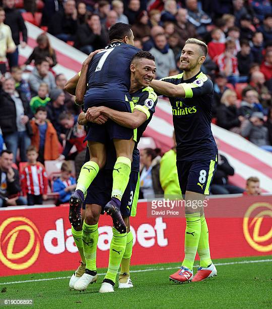 Alexis Sanchez celebrates scoring his 2nd goal Arsenal's 4th with Kieran Gibbs and Aaron Ramsey during the Premier League match between Sunderland...