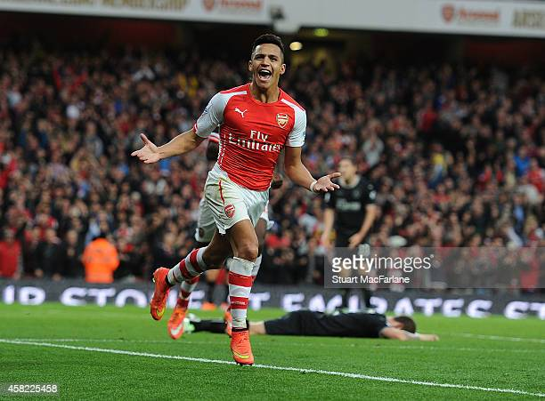 Alexis Sanchez celebrates scoring the 1st Arsenal goal during the Barclays Premier League match between Arsenal and Burnley at Emirates Stadium on...