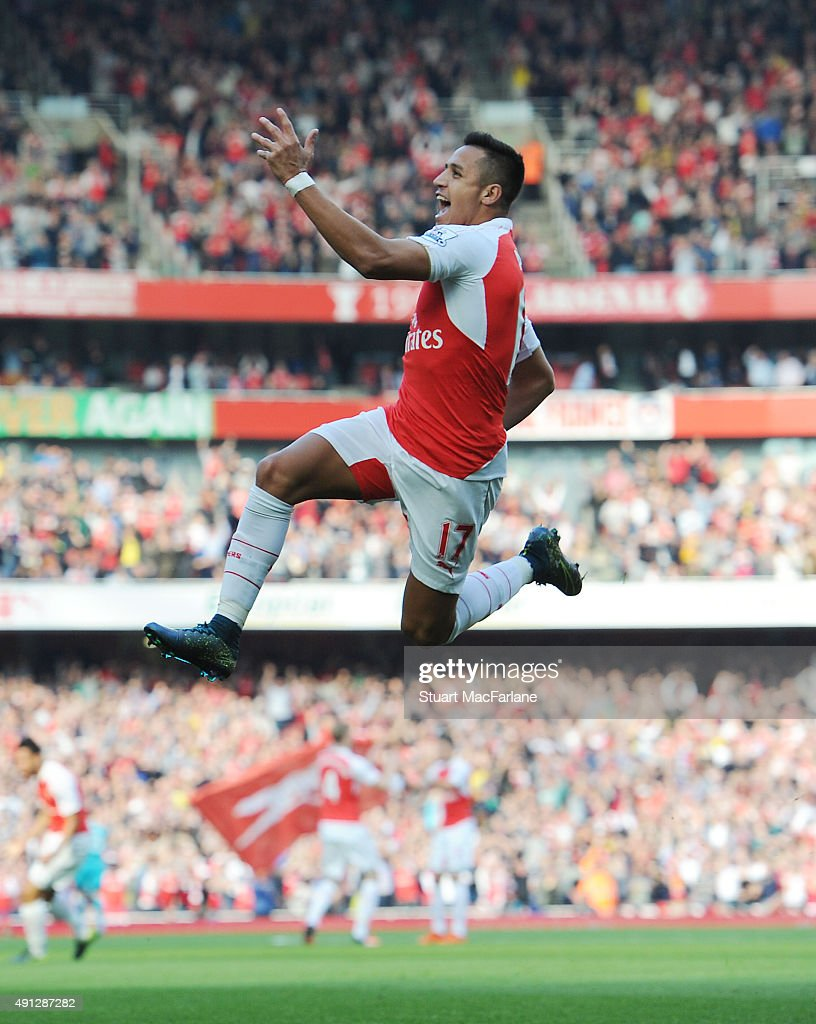 Alexis Sanchez celebrates scoring the 1st Arsenal goal during the Barclays Premier League match between Arsenal and Manchester United at Emirates Stadium on October 4, 2015 in London, England.