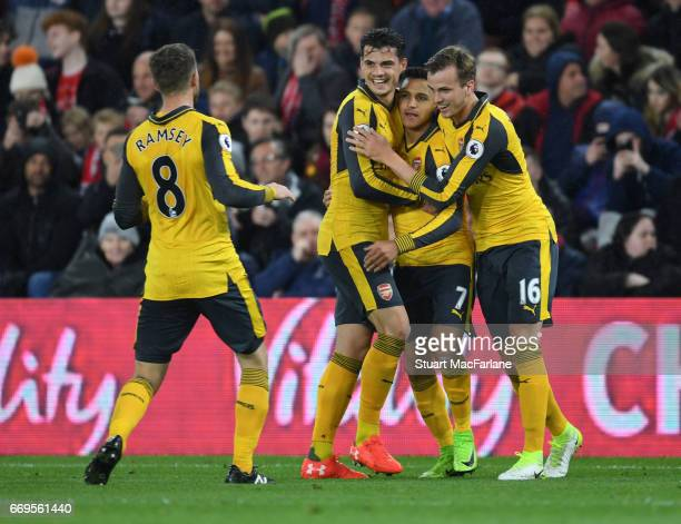 Alexis Sanchez celebrates scoring the 1st Arsenal goal with Aaron Ramsey Granit Xhaka and Rob Holding during the Premier League match between...