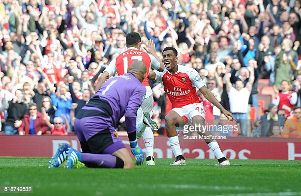 Alexis Sanchez celebrates scoring the 1st Arsenal goal with Alex Iwobi during the Barclays Premier League match between Arsenal and Watford at...