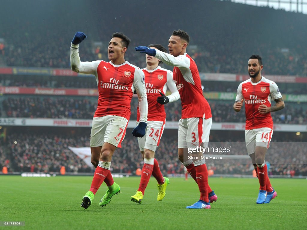 Alexis Sanchez celebrates scoring the 1st Arsenal goal with (2ndL) Kieran Gibbs during the Premier League match between Arsenal and Hull City at Emirates Stadium on February 11, 2017 in London, England.