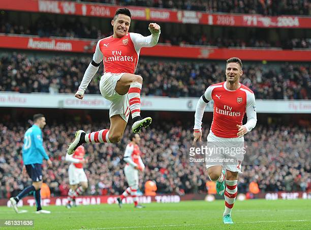 Alexis Sanchez celebrates scoring the 2nd Arsenal goal during the Barclays Premier League match between Arsenal and Stoke City at Emirates Stadium on...