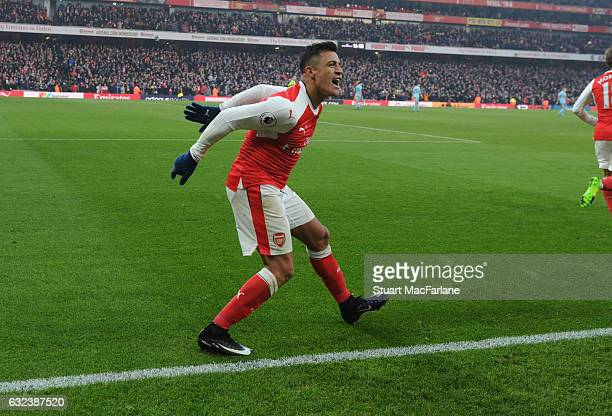 Alexis Sanchez celebrates scoring the 2nd Arsenal goal during the Premier League match between Arsenal and Burnley at Emirates Stadium on January 22...