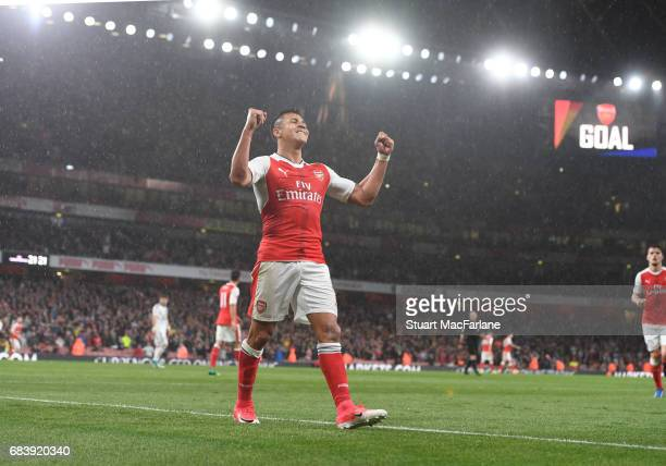 Alexis Sanchez celebrates scoring the 2nd Arsenal goal during the Premier League match between Arsenal and Sunderland at Emirates Stadium on May 16...