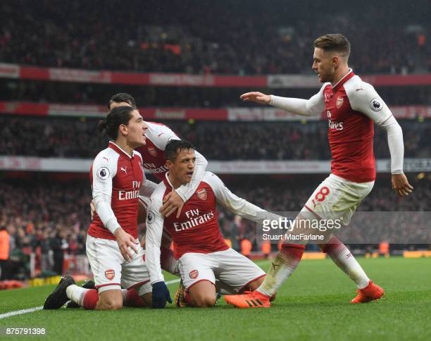 Alexis Sanchez celebrates scoring the 2nd Arsenal goal with Hector Bellerin and Aaron Ramsey during the Premier League match between Arsenal and...