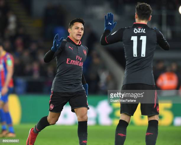 Alexis Sanchez celebrates scoring the 2nd Arsenal goal with Mesut Ozil during the Premier League match between Crystal Palace and Arsenal at Selhurst...