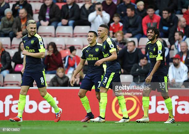 Alexis Sanchez celebrates scoring the 4th Arsenal goal with Aaron Ramsey Kieran Gibbs and Mohamed Elneny during the Premier League match between...