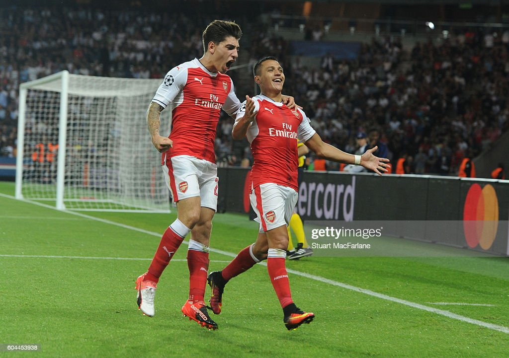 Alexis Sanchez celebrates scoring the Arsenal goal with (L) Hector Bellerin during the UEFA Champions League match between Paris Saint-Germain and Arsenal at Parc des Princes on September 13, 2016 in Paris, .
