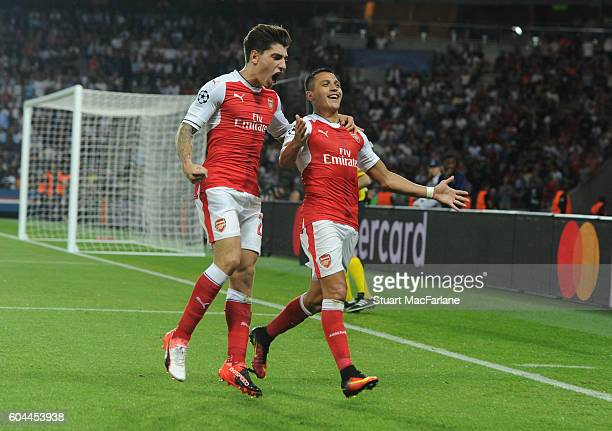 Alexis Sanchez celebrates scoring the Arsenal goal with Hector Bellerin during the UEFA Champions League match between Paris SaintGermain and Arsenal...