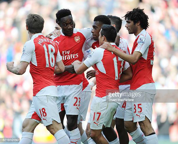 Alexis Sanchez celebrates scoring the Arsenal goal with Mohamed Elneny Nacho Monreal Danny Welbeck and Akex Iwobi during the Barclays Premier League...