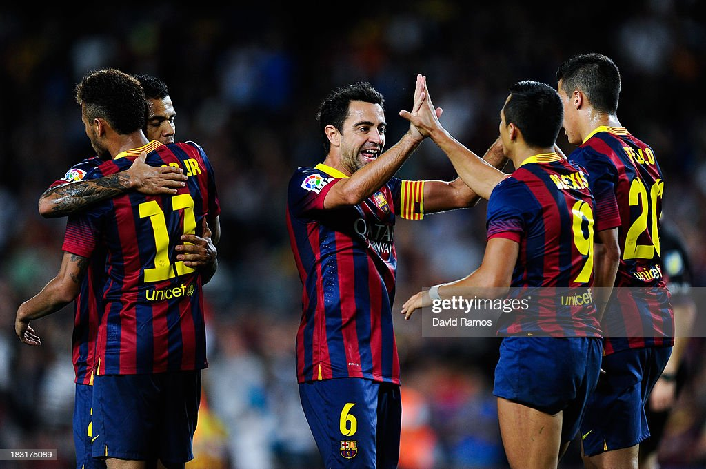 Alexis Sanchez (R) celebrates with his team-mates after scoring his team's third goal of FC Barcelonaduring the La Liga match between FC Barcelona and Real Valladolid CF at Camp Nou on October 5, 2013 in Barcelona, Spain.