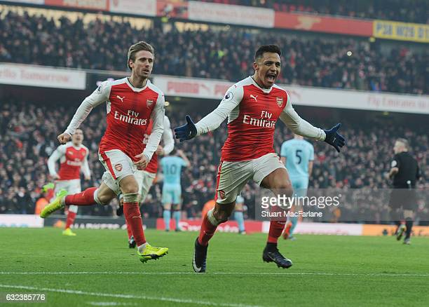 Alexis Sanchez celebrstes scoring the 2nd Arsenal goal with Nacoh Monreal during the Premier League match between Arsenal and Burnley at Emirates...