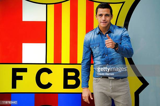Alexis Sanchez from Chile is presented as a newly signed player for FC Barcelona at Camp Nou sports complex on July 24 2011 in Barcelona Spain