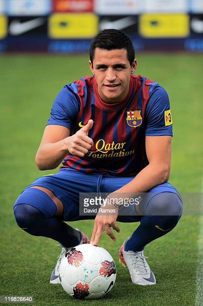 Alexis Sanchez from Chile poses during his presentation as the new signing for FC Barcelona at the Joan Gamper training camp sports complex on July...