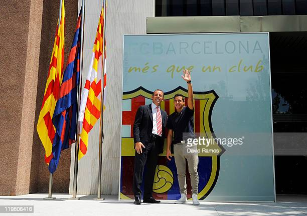 Alexis Sanchez from Chile poses with the president of FC Barcelona Sandro Rosell during his presentation as the new signed player for FC Barcelona at...
