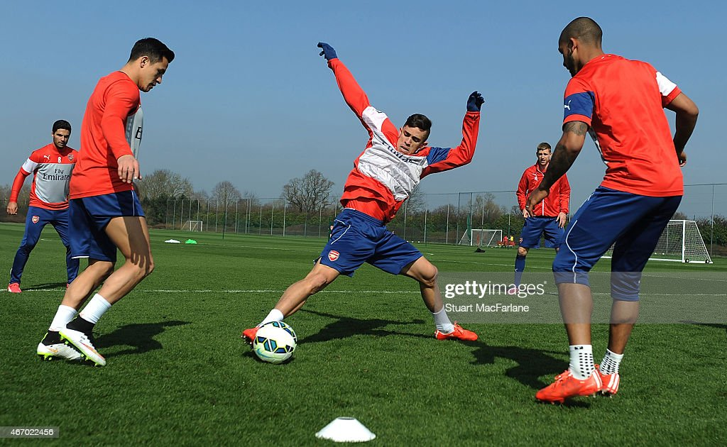 Alexis Sanchez, Gabriel and Theo Walcott of Arsenal during a training session at London Colney on March 20, 2015 in St Albans, England.