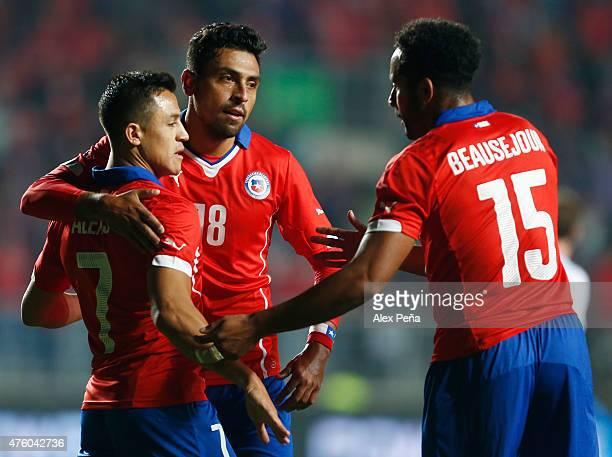 Alexis Sanchez Gonzalo Jara and Jean Beausejour Coliqueo of Chile celebrate after a friendly match between Chile and El Salvador at El Teniente de...
