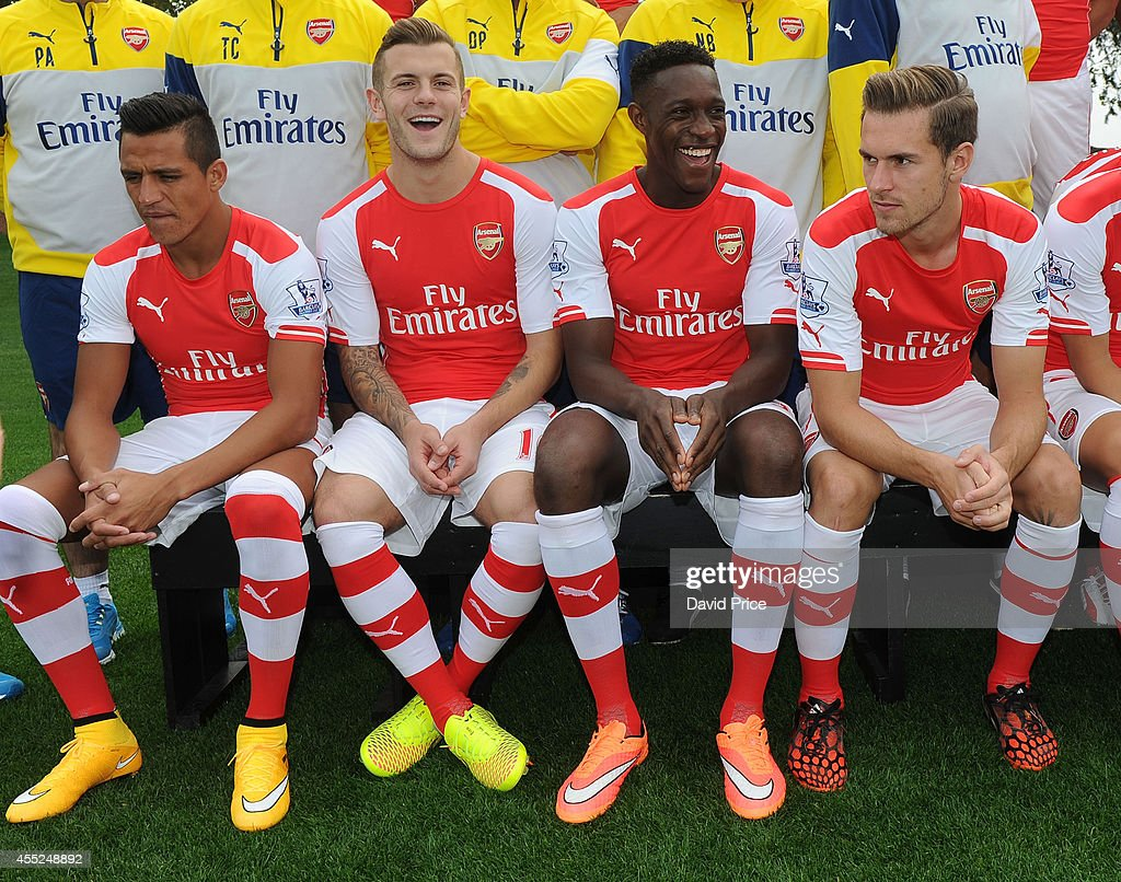 Alexis Sanchez, Jack Wilshere, Danny Welbeck and Aaron Ramsey of Arsenal during the 1st team squad photo at London Colney on September 11, 2014 in St Albans, England.
