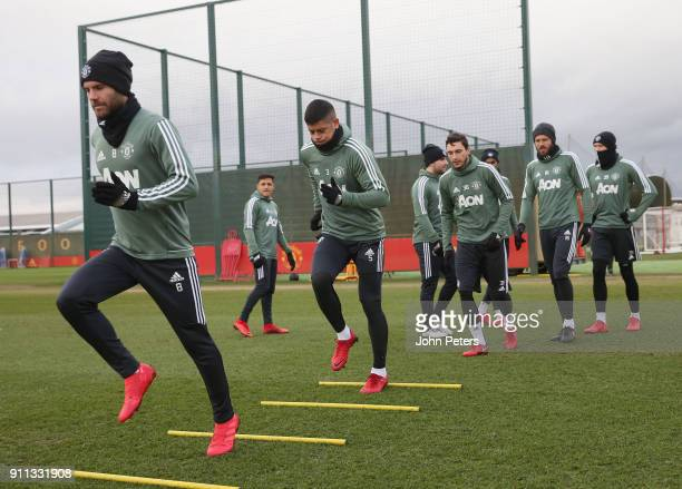 Alexis Sanchez Juan Mata Marcos Rojo and Matteo Darmian of Manchester United in action during a first team training session at Aon Training Complex...