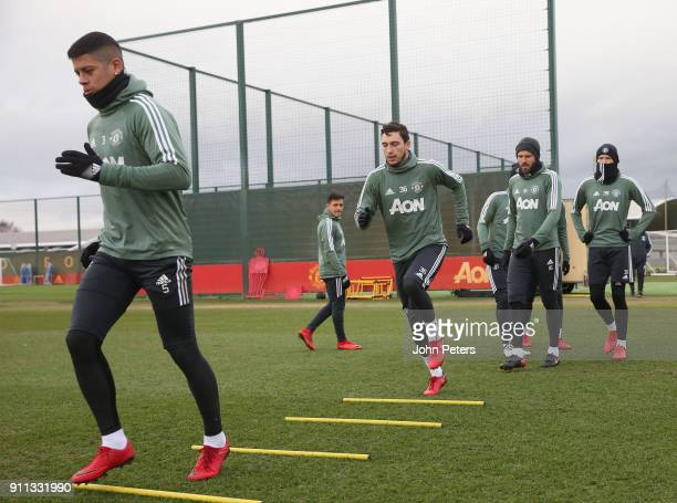 Alexis Sanchez Marcos Rojo and Matteo Darmian and Michael Carrick of Manchester United in action during a first team training session at Aon Training...