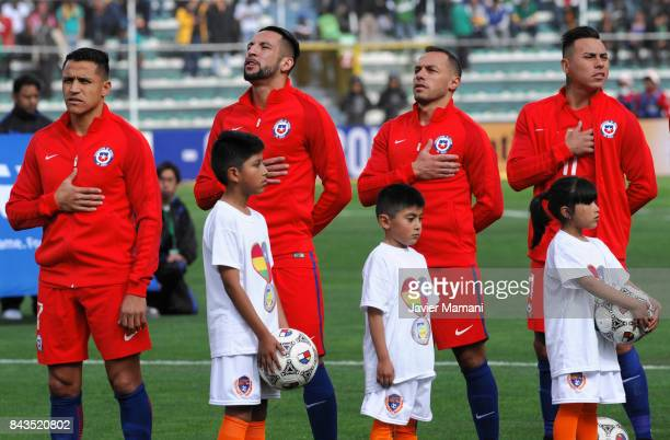Alexis Sanchez Mauricio Isla Marcelo Diaz and Eduardo Vargas of Chile sing the Natinoal Anthem prior to a match between Bolivia and Chile as part of...