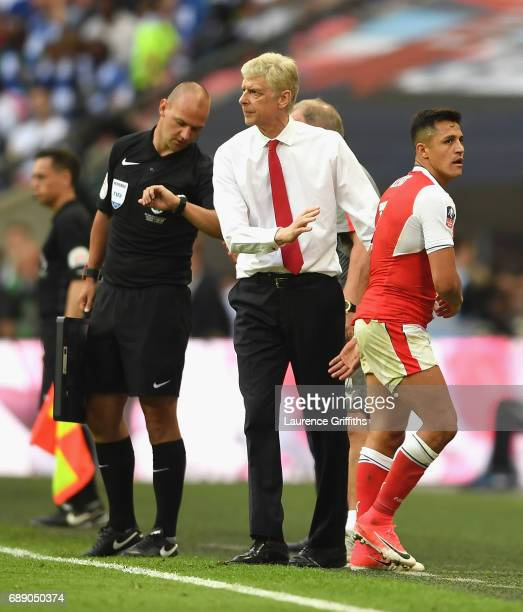 Alexis Sanchez of Arsenal and Arsene Wenger Manager of Arsenal embrace during the Emirates FA Cup Final between Arsenal and Chelsea at Wembley...