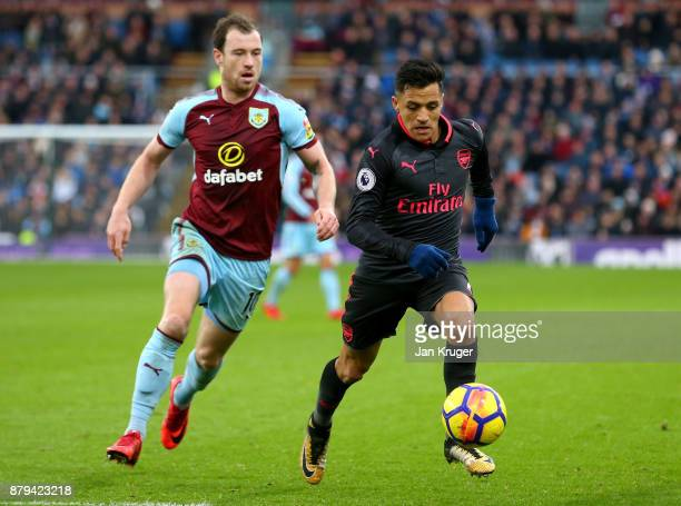 Alexis Sanchez of Arsenal and Ashley Barnes of Burnley in action during the Premier League match between Burnley and Arsenal at Turf Moor on November...