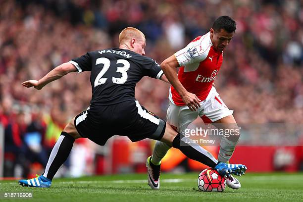Alexis Sanchez of Arsenal and Ben Watson of Watford compete for the ball during the Barclays Premier League match between Arsenal and Watford at...