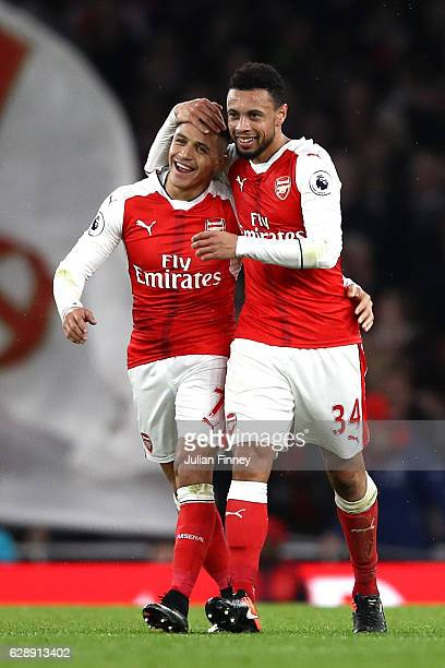 Alexis Sanchez of Arsenal and Francis Coquelin of Arsenal celebrate after Theo Walcott of Arsenal scored Arsenals first goal during the Premier...